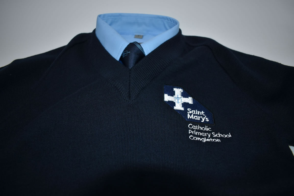 Navy V neck school jumper with logo